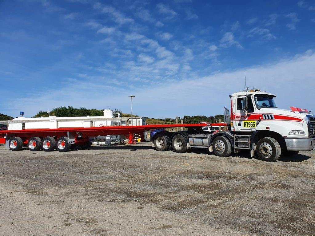 Mack Granite quad tractor unit x TCM quad flat deck trailer